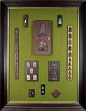 Vintage Display of Thai Amulets & Votive Tablets