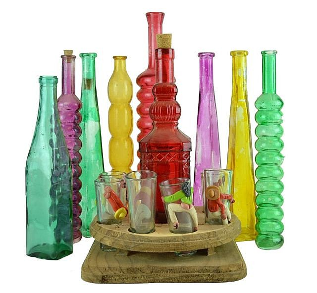 Lot of bottles & decorative glasses. Wooden stand.