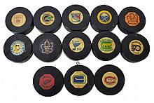 13 Vintage National Hockey League Puck Lot