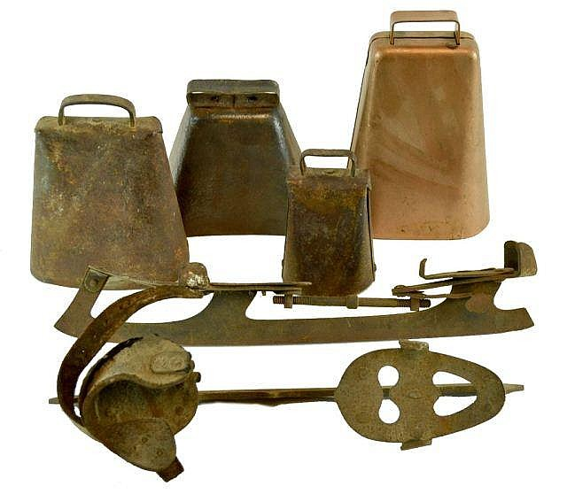 Primitive lot of Cow Bells & Antique Skates.