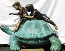 Two Kids Riding Turtle Bronze Statue