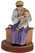 A Biscuit Porcelain Figurine of a Seated Peasant Mother and Child