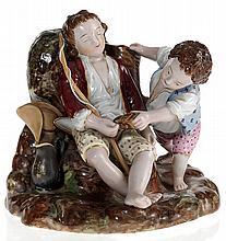 A Porcelain Composition of a Child Teasing a Sleeping Friend