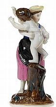 A Porcelain Figurine of a Woman Punishing Her Child