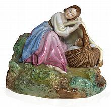 A Porcelain Figurine of a Mother with a Sleeping Child