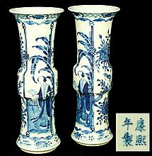 A pair of Chinese porcelain Gu form vases painted