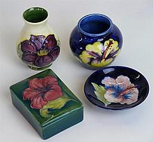 Four pieces of Walter Moorcroft pottery To include