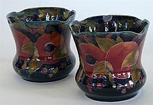 A pair of William Moorcroft pottery jardineres of