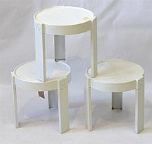 A set of three white plastic stacking stools Circa