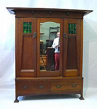 A fine quality British Arts & Crafts medium oak tw