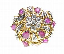 A ruby and diamond bombe dress ring Set to the centre with a diamond cluste