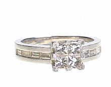 A diamond set ring by David Morris With four princess-cut diamonds centrall