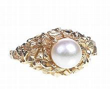 A cultured pearl dress ring The cultured pearl centrally set to an abstract