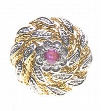 A ruby and diamond bombe dress ring The centre set with a circular shaped r