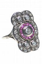 An early 20th century synthetic ruby and diamond panel ring Centering a rou