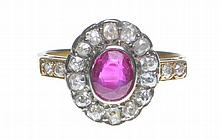 A ruby and diamond cluster ring The oval mixed-cut ruby to an old-cut diamo