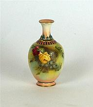 A Royal Worcester hand painted vase Of bulbous form, depicting roses, green