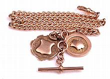 A 9ct rose gold Albert link chain with two 9ct gold sporting medals attache
