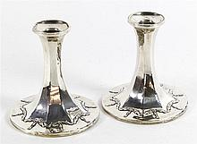A pair of George V hallmarked silver candlesticks Of octagonal form, repous