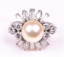 A platinum cultured pearl and diamond set cocktail ring The central culture