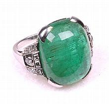An exceptional Art Deco emerald and diamond set cocktail ring, circa 1935 T