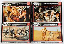 Four 1977 Star Wars jigsaws Complete with 150 pieces by Waddingtons compris