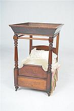 A rare miniature early 19th Century mahogany four poster doll's bed With a