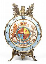 An unusual erthenware and gilt metal commemorative easel clock With a 35cm