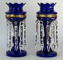 A pair of late Victorian opaline and blue glass table lustres  Of typical f