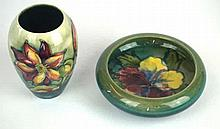 Two pieces of Walter Moorcroft pottery to include ovoid form vase Decorated