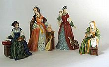 A collection of four Royal Doulton limited edition Henry VIII wives figures
