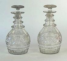 A pair of Regency cut glass mallet decanters Of typical rounded form rising