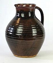 Geoffrey Whiting Avoncroft Studio Pottery jug Of ovoid form, having ribbed