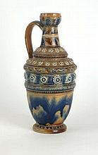 A Doulton Lambeth Art ware jug Of cylindrical form, having hand painted and