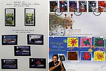 Thirteen albums containing stamps from the the Isle of Man  Comprising five