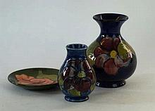 Three pieces of Moorcroft Pottery To include a vase of baluster form, decor