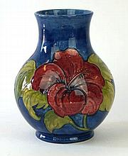 A Moorcroft pottery vase of baluster form  Decorated in a Hibiscus pattern