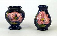 Two Moorcroft Pottery vases One of baluster form, each decorated the Magnol