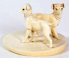 A late 19th/early 20th Century carved ivory dog figure group, possibly Germ