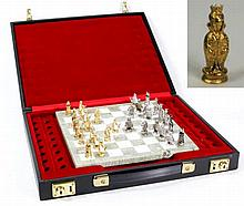 A fine quality Asprey 9ct gold chess set Comprising thirty two pieces, each