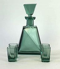 An Art Deco green glass drinking set To include decanter, four shot glasses