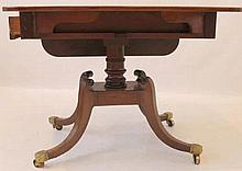 A Regency period mahogany drop leaf pedestal supper table The single frieze