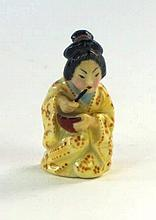 A Royal Worcester 'Japanese girl' candle snuffer, dated 1898 Modelled as a