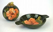 Two pieces of Walter Moorcroft pottery Decorated in hibiscus pattern on a g