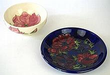 Two pieces of Moorcroft Pottery  To include circular plate decorated in the