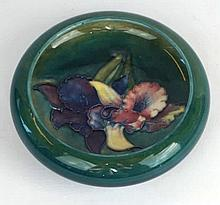A Walter Moorcroft Orchid pattern circular bowl On a green ground, impresse