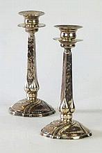 A pair of Edward VII Arts & Crafts hallmarked silver taper sticks Having de