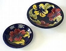 Two pieces of Moorcroft Pottery Decorated in the Hibiscus pattern, on a blu