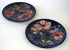 Two Moorcroft Pottery circular chargers Each decorated in the Anemone patte