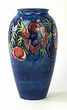 A Moorcroft Pottery vase Of tapering cylindrical form decorated in the Anem